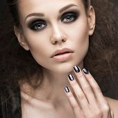 pic of nail-design  - Beautiful girl in leather jacket with bright makeup and manicure Cat - JPG
