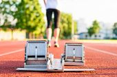 image of sprinters  - Closeup of a starting block - JPG