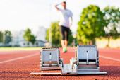 picture of sprinter  - Closeup of a starting block - JPG