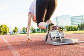 stock photo of sprinter  - Side view of sprinter preparing to start - JPG