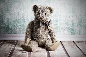 stock photo of ugly  - Ugly sitting old brown vintage Teddy bear - JPG
