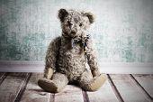 foto of ugly  - Ugly sitting old brown vintage Teddy bear - JPG