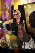 stock photo of dog clothes  - Pinup and Rockabilly styled woman with a dog posing in 1950 - JPG