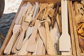 stock photo of stall  - A vast assortment of handcrafted kitchen utensils as seen on a market stall - JPG