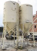 stock photo of dispenser  - Plaster dispensers or hoppers on Spanish building site - JPG
