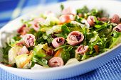 image of squid  - Healthy salad made of lettuce arugula and boiled squid - JPG