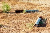 stock photo of artillery  - Remains of Field Artillery lying around in the desert is Evidence of the War in Angola - JPG