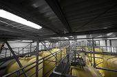 stock photo of pipe-welding  - Industrial interior with welded silos from above - JPG