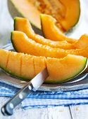 foto of cantaloupe  - Cantaloupe Melon Slices On Metal Rustic Plate - JPG