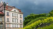 stock photo of tenement  - Facade of an ancient tenement at the stormy sky in Bielsko - JPG