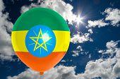 foto of ethiopia  - balloon in colors of ethiopia flag flying on blue sky  - JPG