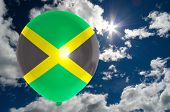 foto of jamaican flag  - balloon in colors of jamaica flag flying on blue sky  - JPG