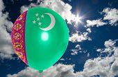 pic of turkmenistan  - balloon in colors of turkmenistan flag flying on blue sky  - JPG