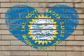 picture of south american flag  - heart shaped flag in colors of south dakota on brick wall - JPG