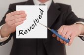 picture of revolt  - Revolted man in suit cutting text on paper with scissors - JPG