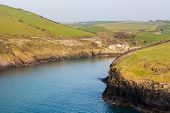 picture of west village  - South West Coast Path along hillside above village of Port Quin Cornwall England UK - JPG
