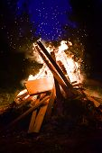stock photo of bonfire  - Big bonfire and sparks in the night - JPG