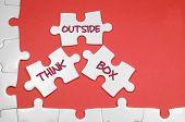 stock photo of thinking outside box  - Think Outside Box word on white puzzle  - JPG