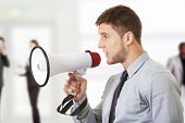 picture of shout  - Handsome businessman shouting through megaphone - JPG