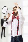 pic of suspenders  - Funny man wearing suspenders shouting with megaphone - JPG