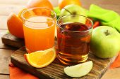 stock photo of fruit-juice  - Assortment of healthy fresh juices and fruits on wooden table background - JPG