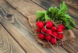 picture of radish  - Fresh organic radish on a old wooden background - JPG
