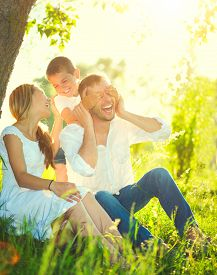 stock photo of father child  - Happy joyful young family father - JPG