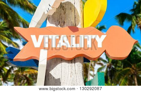 Vitality direction sign in a tree