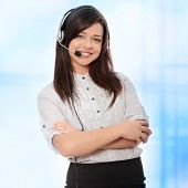 Call center woman with headset. Over abstract blue background