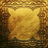 Постер, плакат: Gold metal plate with classic Arabic ornament metal collection Golden texture with metal carved Is