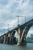 stock photo of dnepropetrovsk  - Arched bridge in a big Ukrainian city Dnepropetrovsk - JPG