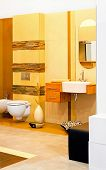 foto of lavabo  - Interior shot of yellow marble tiles bathroom - JPG