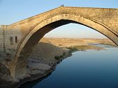 stock photo of euphrates river  - powerful stone bridge in nothern mesopotamia eastern turkey - JPG