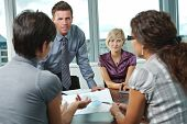 stock photo of communication people  - Group of young business people talking on business meeting at office - JPG