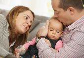 stock photo of nuclear family  - Baby girl sleeping in father - JPG