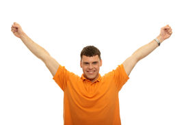 picture of hands up  - A young man joyously throws his hands up in the air - JPG