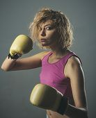Fitness Trainer Or Sportive Lady Boxing, Training Hard. Girl Ready To Hit With Boxing Gloves. Woman  poster