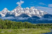 Grand Teton Mountains from Schwabachers Landing on the Snake River at morning. Low clouds lay on th poster
