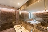 Luxurious marble bathroom with hydromassage for two people. Nobody inside poster