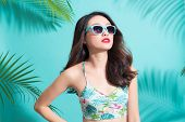 Portrait Beauty Sexy Asian Model With Perfect Face Wearing A Sunglass And Elegant Bikini On Palm Tre poster
