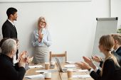 Smiling Senior Businesswoman Boss And Team Clapping Hands At Meeting, Happy Woman Executive Applaudi poster