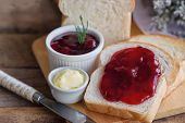 Delicious Toast Bread Served With Butter And Spread With Strawberry Jam. Homemade Bread And Jam On W poster