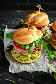 Fresh Home Sandwich With Avocado Guacamole, Tomatoes, Arugula, Red Onion And Ham poster