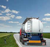 stock photo of tank truck  - new truck with tank trailer driving the highway - JPG