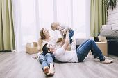 Family Together Happy Young Beautiful With A Little Baby Moves With Boxes To A New Home poster