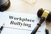 Documents About Workplace Bullying In A Court. poster