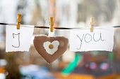 I Love You background. Heart and note with words I Love You hanging on a clothesline poster