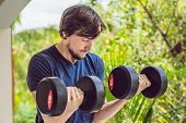 Bicep Curl - Weight Training Fitness Man Outside Working Out Arms Lifting Dumbbells Doing Biceps Cur poster