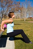 picture of hottie  - Young woman performing tricep dips on a bench - JPG