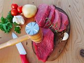 Red Meat Slices Tendered With A Meat Pounder On Wooden Board. Veal Beef Slices Ready For Schnitzel O poster